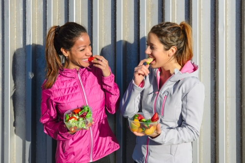 Female walkers eating a fruit snack