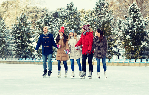 People ice skating in winter