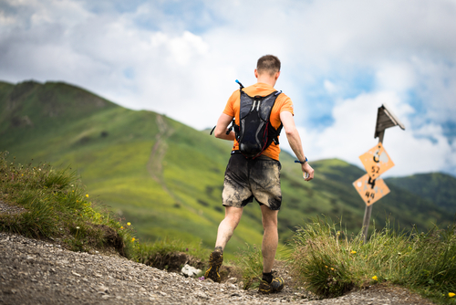 Hiker walking with walking backpack