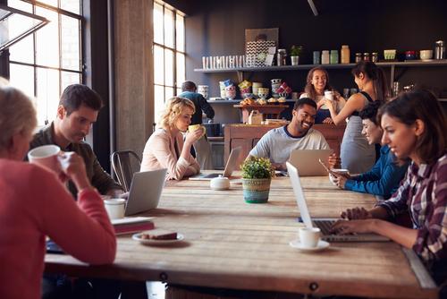 Urban coffee shop with people