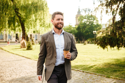 Man walking in the park with coffee