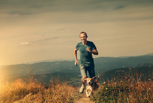 Happy man running with dog