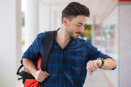 Man checking watch running late