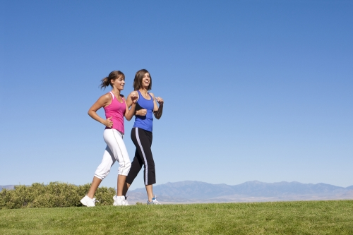 Women fitness walking in a natural setting