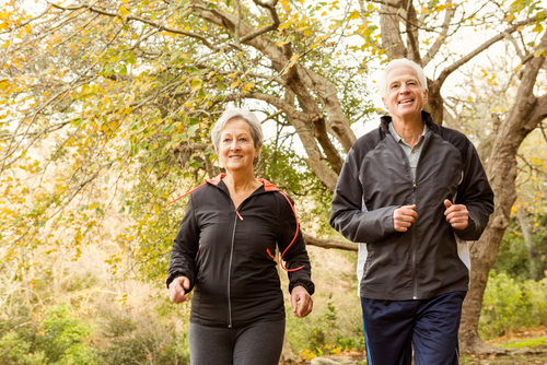 Older couple walking for fitness