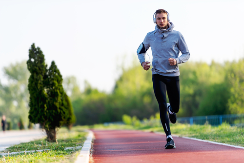 Man running on jogging path