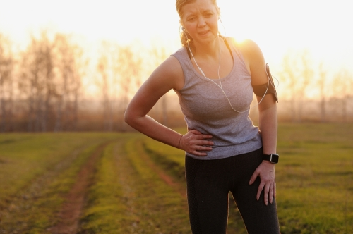 Woman feeling pain after fitness walking