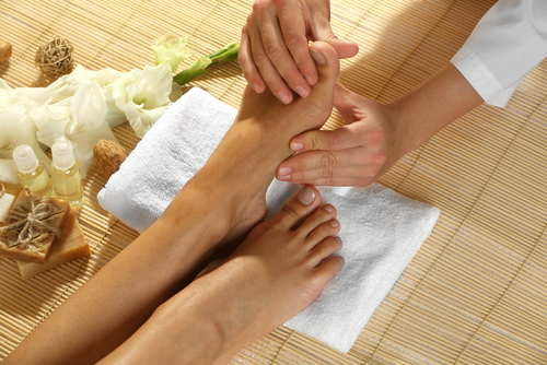 Foot massage in spa setting