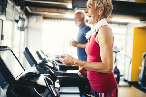 Senior couple walking on treadmills