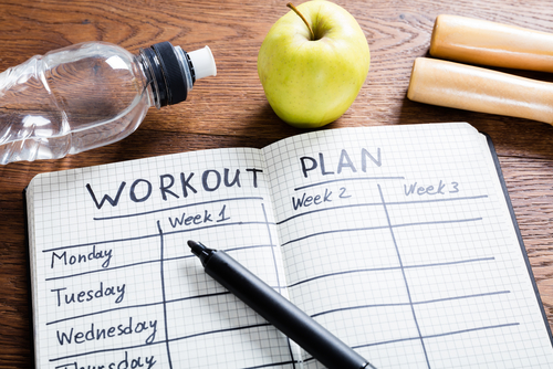 Workout plan in notebook concept