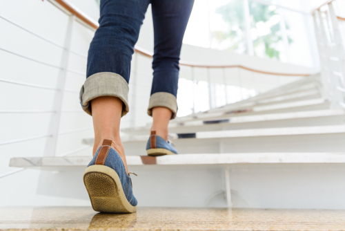 woman walking up stairs for exercise