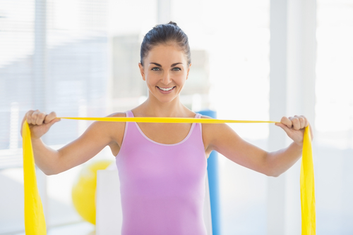 Woman showing off exercise resistance band