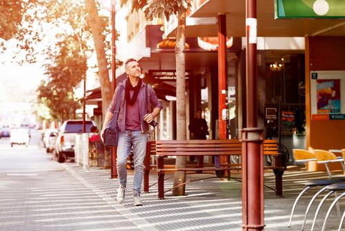 Man walking exploring city center