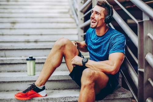 Jogger listening to podcast taking a break