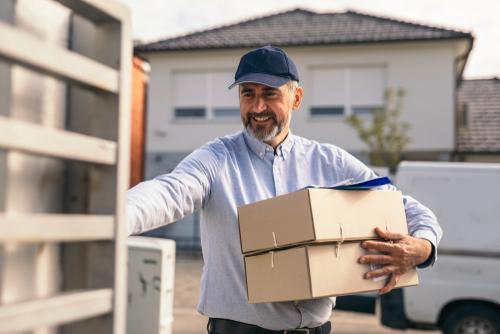 Postal worker delivering packages