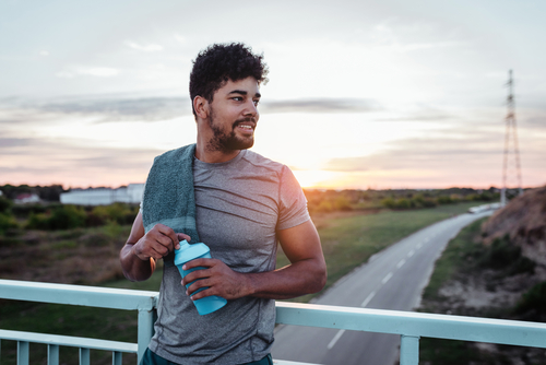 Man resting on a bridge after a jog