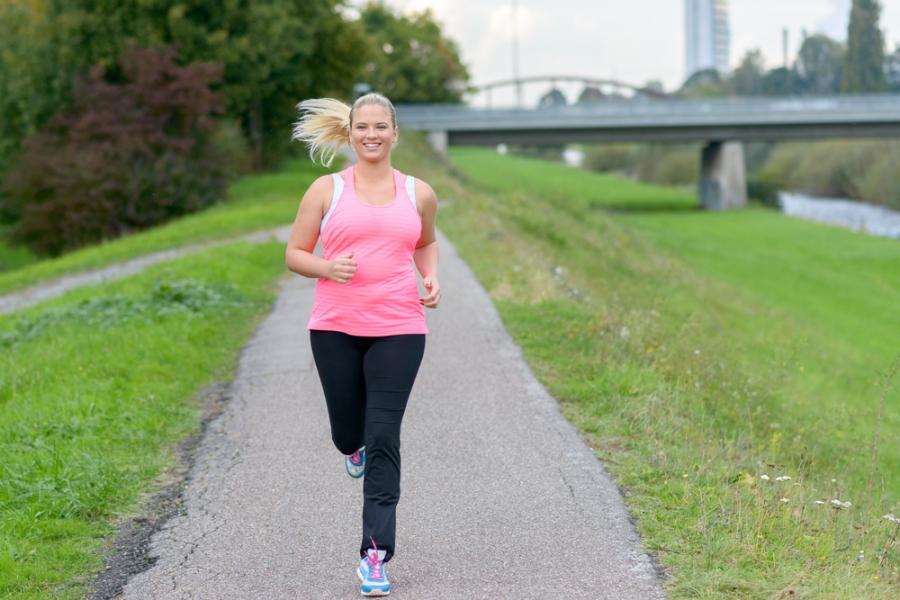 Plus sized female jogger on running path