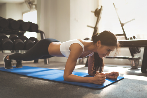 Woman planking in a home gym