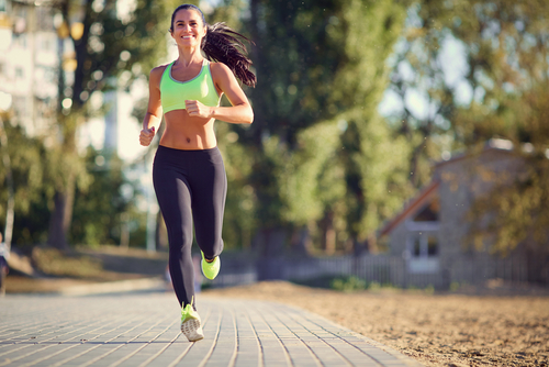 Fit woman jogging in a suburban street