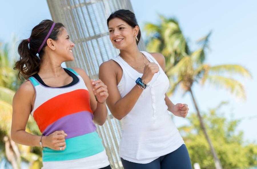 Two women fitness walking in the park