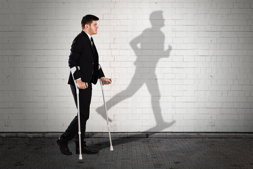 Businessman with injury wanting to walk more