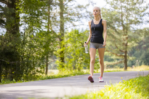 Athletic woman walking for fitness in park