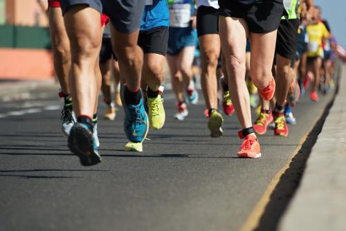 Marathon runners feet focused