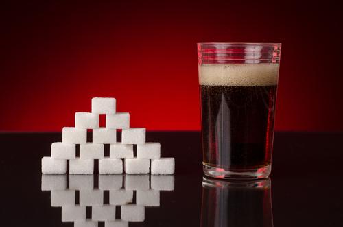 Soda with sugar cubes unhealthy soda concept
