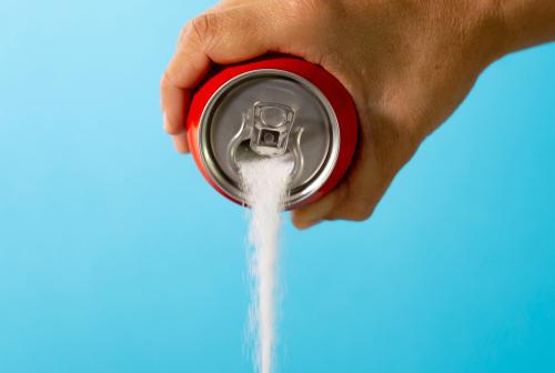 soda can pouring sugar unhealthy soda concept