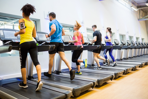 People running on treadmills at the gym