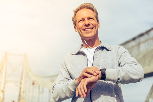 Fit middle-aged man checking watch
