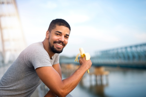 Man eating banana after a run or walk