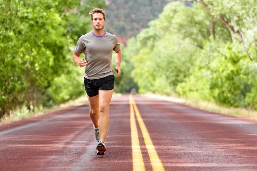 Man walking fast for fitness on country road