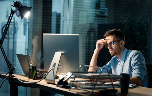 Tired office worker working late