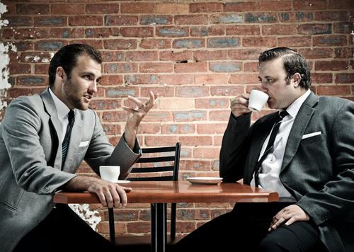 Men drinking coffee in a cafe