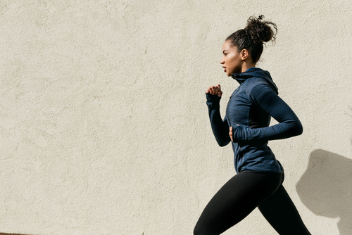 Sporty woman walking fast for fitness