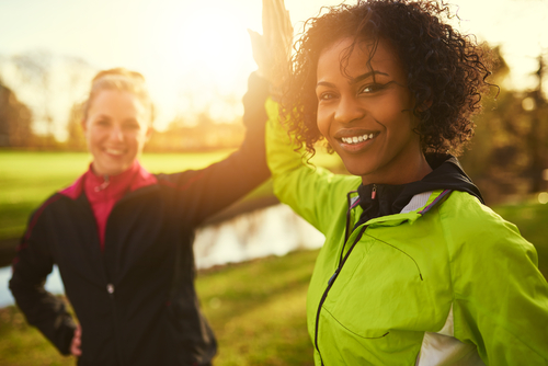 Women high-fiving after exercise
