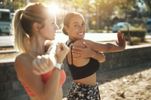Fit women stretching before a workout