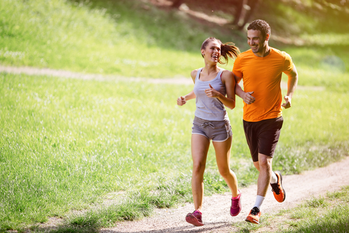 Couple walking or jogging for fitness