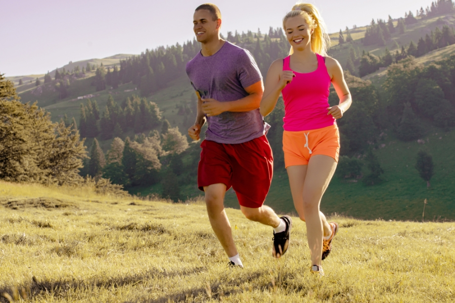 Young fit couple walking in nature for fitness