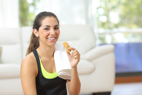 Woman eating a snack after a workout