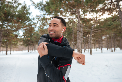 Man warming up before a walk or jog in winter