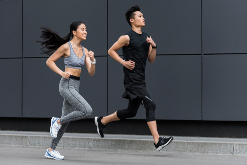Couple jogging in a city street
