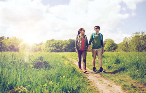 Couple taking a long walk in the countryside